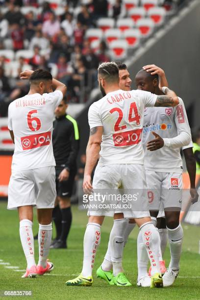 Nancy's French forward Junior Dale celebrates with his teammates after scoring a goal during the French L1 Football match between OGC Nice and AS...