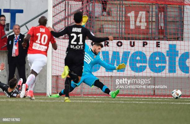 Nancy's French forward Junior Dale scores against Rennes' French goalkeeper Benoit Costil during the French L1 football match between Nancy and...