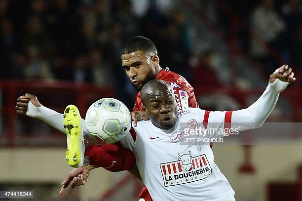 Nancy's French forward Junior Dale vies with Dijon's French forward Lois Diony during the French L2 football match Dijon vs Nancy on May 22 at the...