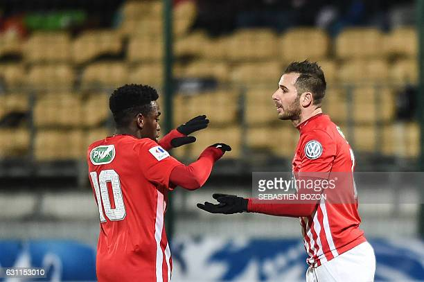 Nancy's French midfielder Antony Robic is congratulated by Nancy's French defender Faitout Maouassa during the French Cup football match between...