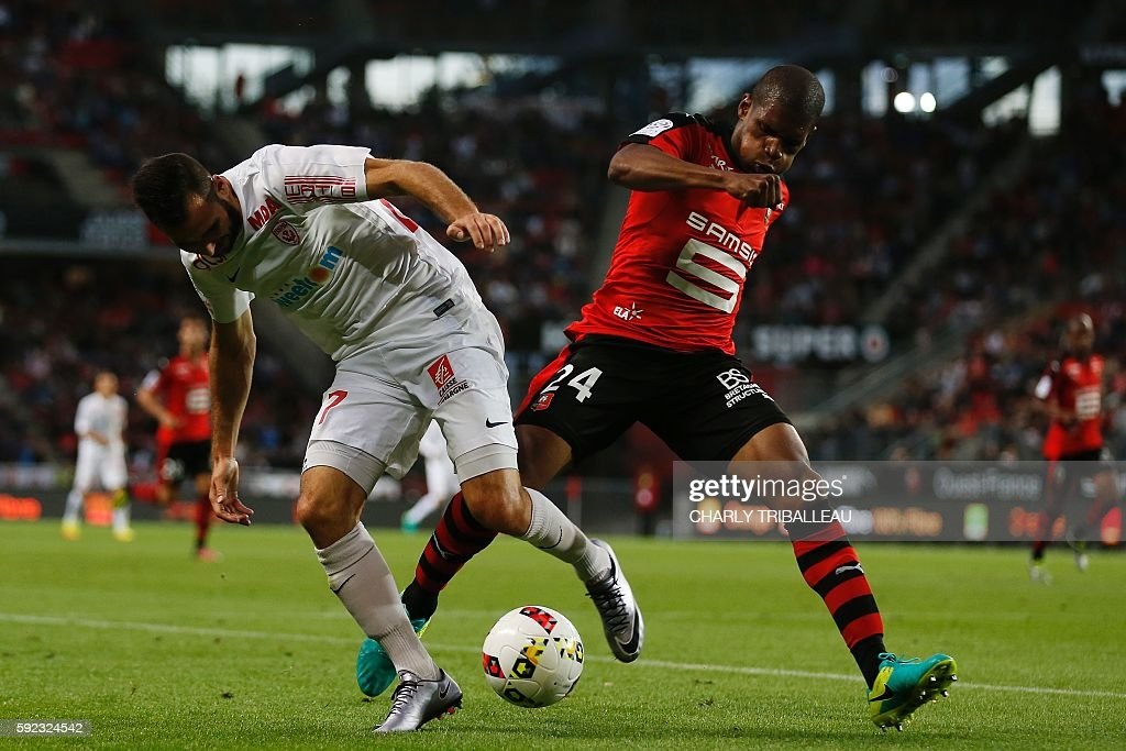 Nancy's French midfielder Antony Robic vies for the ball with Rennes' French defender Ludovic Baal during the French L1 football match between Stade...