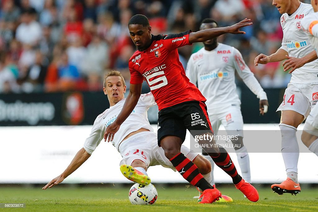 Nancy's French midfielder Benoit Pedretti vies for the ball with Rennes' French forward Wesley Said during the French L1 football match between Stade...
