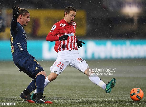 Nancy's French midfielder Benoit Pedretti vies for the ball with Bastia's Algerian midfielder Mehdi Mostefa during the French L1 football match...