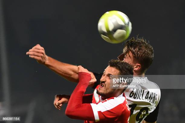 Nancy's French midfielder Jeremy Clement vies Angers' French forward Baptiste Guillaume during the French League Cup match Angers between Nancy on...