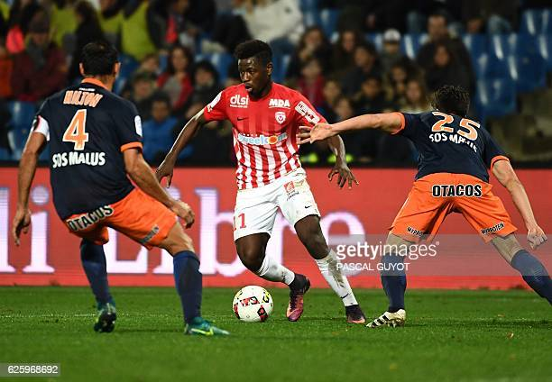 Nancy's French midfielder Karim Coulibaly challenges Montpellier's French defender Mathieu Deplagne and Montpellier's Brazilian defender Victorio...