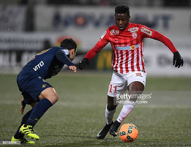 Nancy's French midfielder Karim Coulibaly vies for the ball with Bastia's French defender Gilles Cioni during the French L1 football match between...