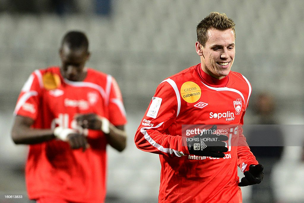 Nancy's French midfielder Romain Grange runs at the end their French L1 football match Olympique of Marseille (OM) versus Nancy (ASNL) at the Velodrome stadium in Marseille on February 3, 2013. AFP PHOTO / BORIS HORVAT
