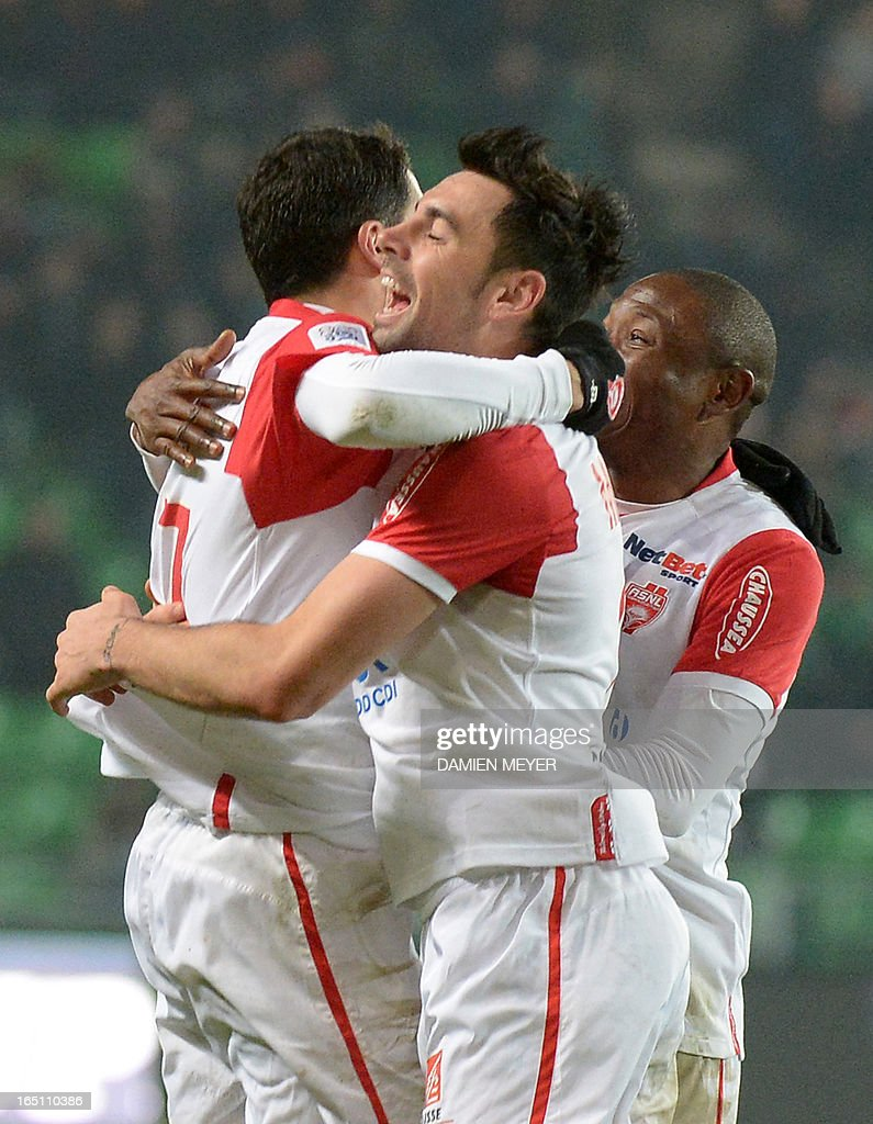 Nancy's French midfielder Thomas Ayasse (L) celebrates with teammates after scoring during the French L1 football match Rennes vs Nancy on March 30, 2013 at the Route de Lorient stadium in Rennes, western France.