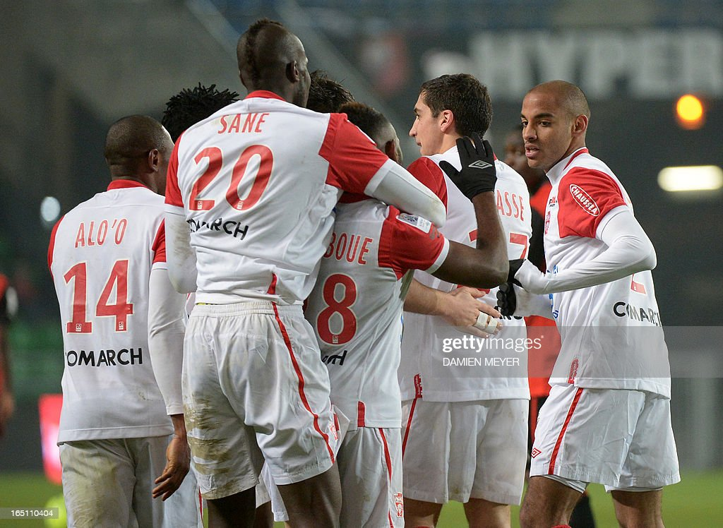 Nancy's French midfielder Thomas Ayasse (2nd R) is congratulated by teammates after scoring during the French L1 football match Rennes vs Nancy on March 30, 2013 at the Route de Lorient stadium in Rennes, western France. AFP PHOTO / DAMIEN MEYER