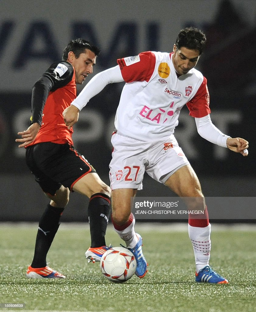 Nancy's French midfielder Thomas Ayasse (R) vies for the ball with Rennes' French midfielder Julien Feret during their French L1 football match Nancy (ASNL) vs Rennes (SRFC) at Marcel Picot Stadium, on November 9, 2012, in Tomblaine.
