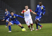 Nancy's French midfielder Yohann Mollo vies for the ball with Bastia's French defender Gilles Cioni and Bastia's French midfielder Sambou Yatabare...