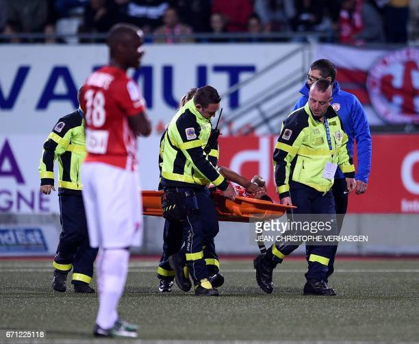 Nancy's French midfielder Youssef Ait Bennasser leaves the pitch on a stretcher during the French L1 football match between Nancy and Marseille on...