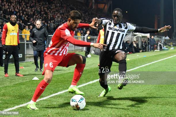 Nancy's French midfielder Youssef Ait Bennasser vies for the ball with Angers' Senegalese defender Issa Cissokho during the French L1 football match...