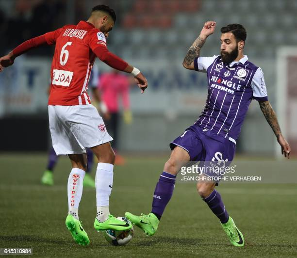Nancy's French midfielder Youssef Ait Bennasser vies for the ball with Toulouse's Swedish midfielder Jakup Jimmy Durmaz during the French L1 football...