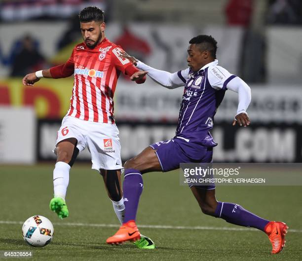 Nancy's French midfielder Youssef Ait Bennasser vies for the ball with Toulouse's Brazilian midfielder Somalia during the French L1 football match...