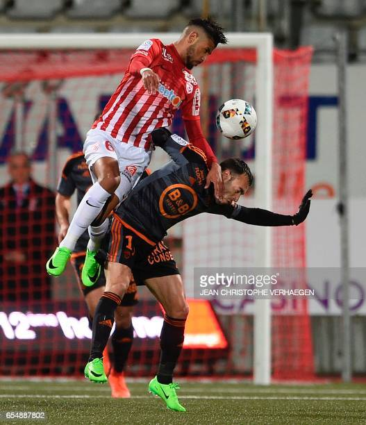 Nancy's French midfielder Youssef Ait Bennasser vies for the ball with Lorient's French midfielder Romain Philippoteaux during the French L1 football...