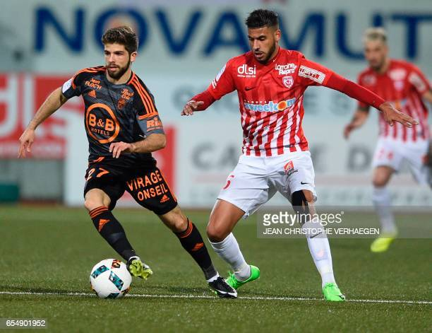 Nancy's French midfielder Youssef Ait Bennasser vies for the ball with Lorient's French midfielder Jimmy Cabot during the French L1 football match...