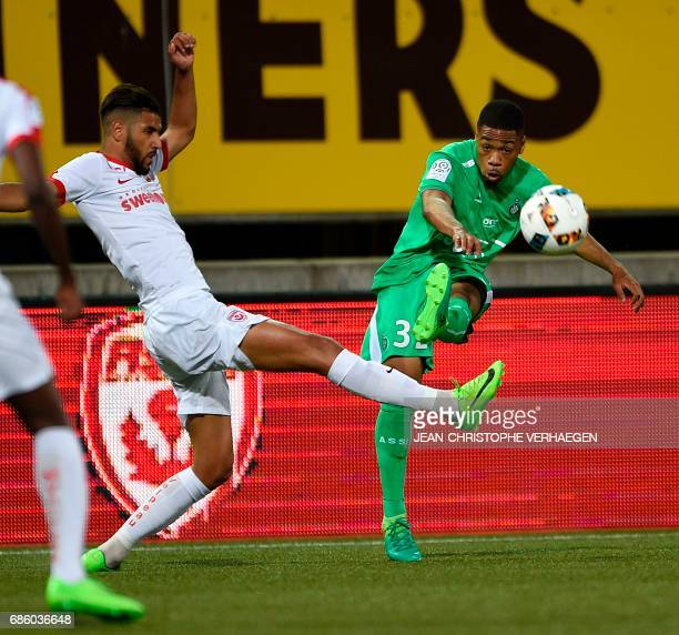 Nancy's French midfielder Youssef Ait Bennasser vies for the ball with SaintEtienne's forward Arnaud Nordin during the French L1 football match...