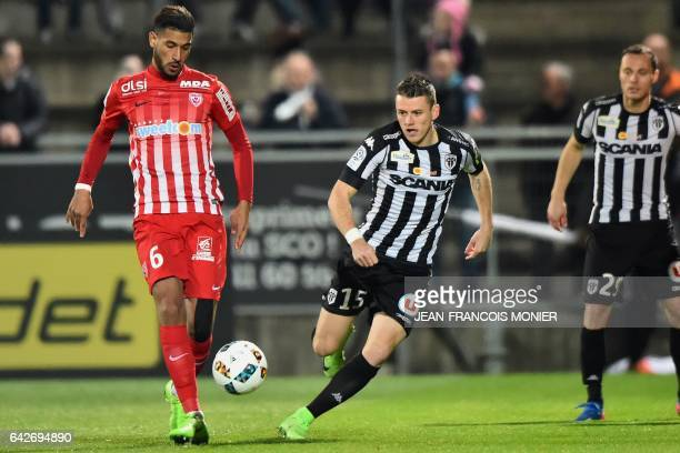 Nancy's French midfielder Youssef Ait Bennasser vies with Angers' French midfielder Pierrick Capelle during the French L1 football match between...