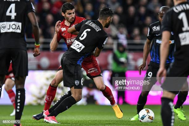 Nancy's French midfielder Youssef Ait Bennasser vies with Dijon's French midfielder Pierre LeesMelou during the French L1 football match between...