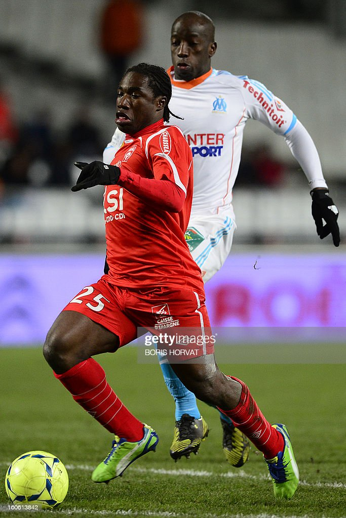 Nancy's Haitian midfielder Jeff Louis (L) vies with Marseille's Senegalese defender Souleymane Diawara (R) during their French L1 football match Olympique of Marseille (OM) versus Nancy (ASNL) at the Velodrome stadium in Marseille on February 3, 2013.