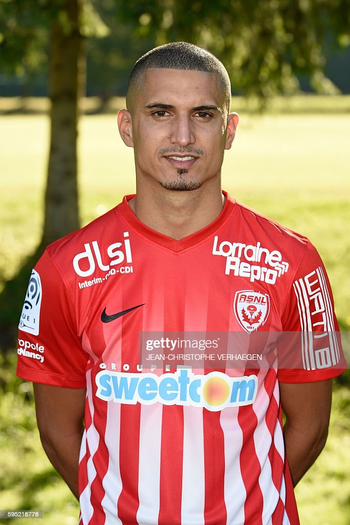 Nancy's L1 football club Morrocan defender Michael Chretien poses for photographers during the presentation of the 20162017 season's team on August...