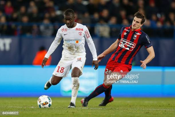 Nancy's Mauritanian midfielder Dialo Guidileye vies for the ball with Caen's Croatian forward Ivan Santini during the French L1 football match...