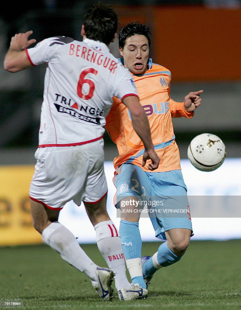 Nancy's midfielder Pascal Berenguer (L) fights for the ball with Marseille's midfielder Samir Nasri (R) during their French League 1 football match at Marcel Picot Stadium, 23 January 2008 in Tomblaine.