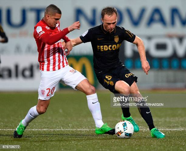 Nancy's Moroccan defender Michael Chretien vies for the ball with Monaco's French forward Valère Germain during the French Ligue1 football match...