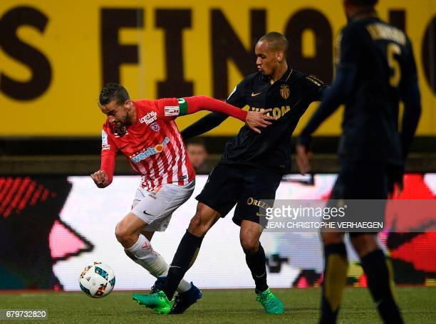 Nancy's Moroccan forward Youssouf Hadji vies for the ball with Monaco's French midfielder Fabinho during the French Ligue 1 football match between...