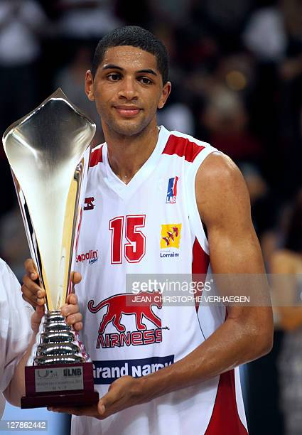 Nancy's Nicolas Batum poses with the MVP Trophy at the end of Nancy vs Chalon Champions' Trophy basketball match on October 2 2011 at Jean Weille...