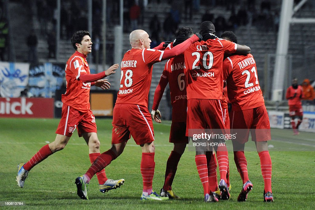 Nancy's players celebrate after scoring during their French L1 football match Olympique of Marseille (OM) versus Nancy (ASNL) at the Velodrome stadium in Marseille on February 3, 2013. AFP PHOTO / BORIS HORVAT