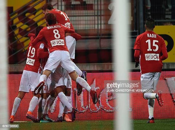 Nancy's players congratulate midfielder Benoit Pedretti after he opened the scoring during the French L1 football match between Nancy and Metz on...