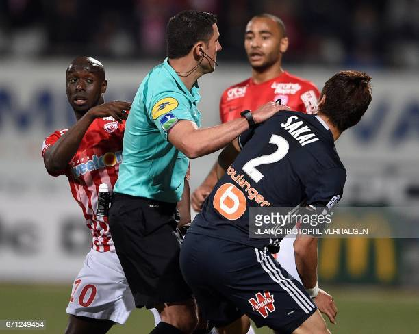 Nancy's Senegalese forward Issiar Dia argues with Olympique de Marseille's Japanese defender Hiroki Sakai during the French L1 football match between...