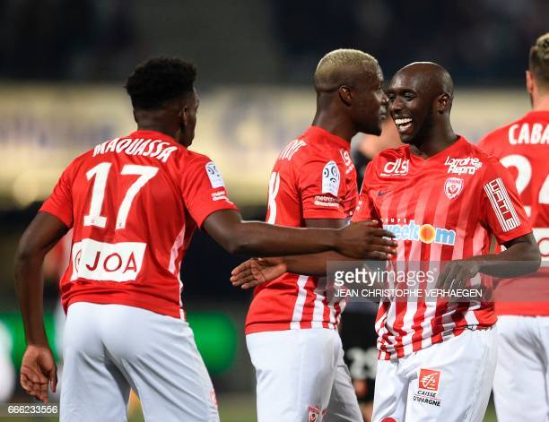 Nancy's Senegalese forward Issiar Dia celebrates with Nancy's French defender Faitout Maouassa after scoring a goal during the French L1 football...