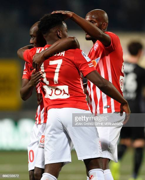 Nancy's Senegalese forward Issiar Dia celebrates with Nancy's French defender Faitout Maouassa and Nancy's French defender Julien Cetout after...