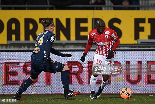 Nancy's Senegalese forward Issiar Dia vies for the ball with Bastia's Algerian midfielder Mehdi Mostefa during the French L1 football match between...