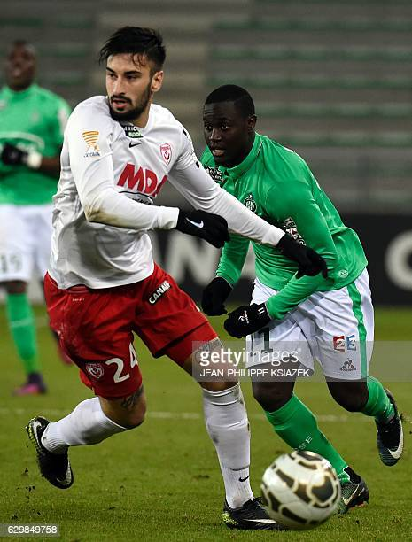 Nancy's Spanish defender Erick Cabaco vies with SaintEtienne's French forward Henri Saivet during the French League Cup football match between...