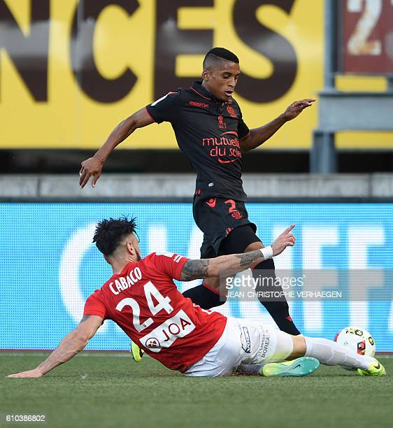 Nancy's SpanishUruguayan defender Erick Cabaco vies for the ball with Nice's Brasilian defender Dalbert Henrique during the French L1 football match...