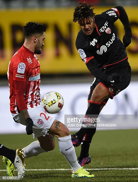 Nancy's SpanishUruguayan defender Erick Cabaco vies for the ball with Dijon's French forward Lois Diony during the French L1 football match between...