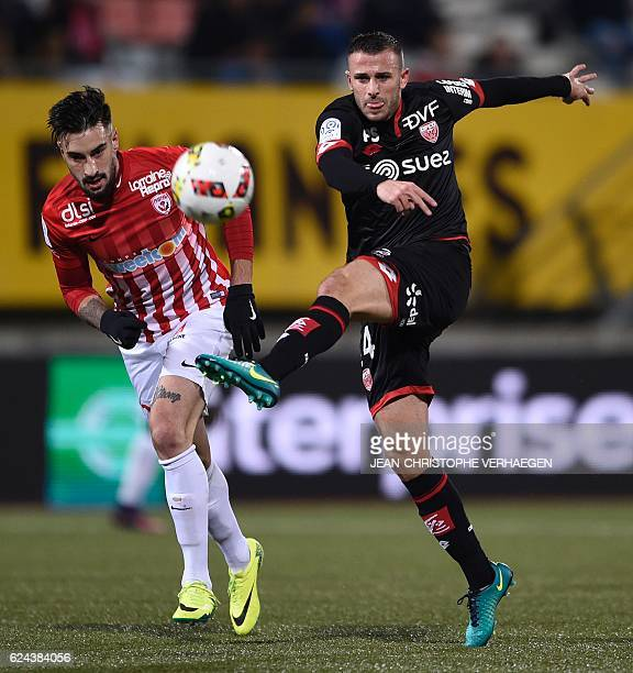 Nancy's SpanishUruguayan defender Erick Cabaco vies for the ball with Dijon's French midfielder Jordan Marie during the French L1 football match...