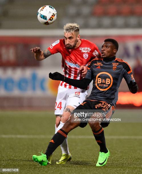 Nancy's SpanishUruguayan defender Erick Cabaco vies for the ball with Lorient's French forward Benjamin Moukandjo during the French L1 football match...