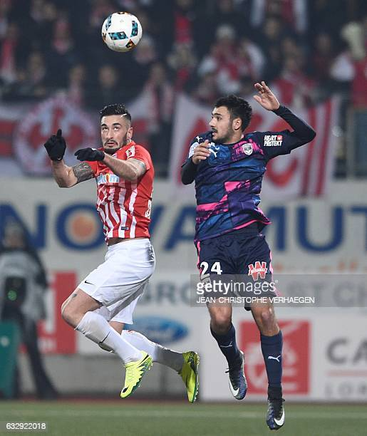 Nancy's SpanishUruguayan defender Erick Cabaco vies with Bordeaux's French forward Gaëtan Laborde during the French L1 football match between Nancy...