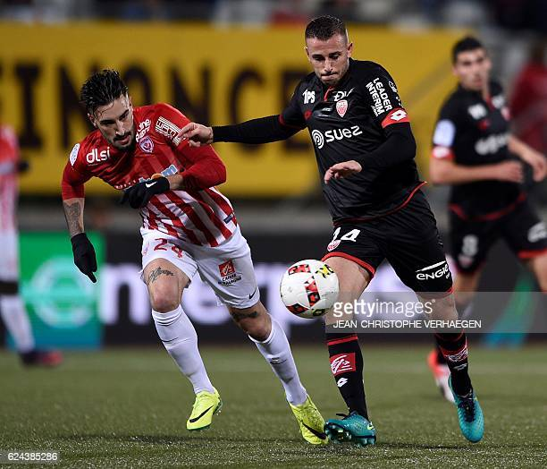 Nancy's SpanishUruguayan defender Erick Cabaco vies with Dijon's French midfielder Jordan Marie during the French L1 football match between Nancy and...