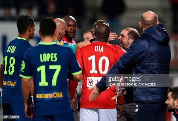 Nancy's Uruguayan coach Pablo Correa argues with main referee Amaury Delerue during the French L1 football match between Nancy and Lille at Marcel...