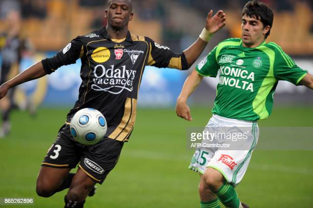 Nancy's Uruguayan defender Damien Macaluso vies with SaintEtienne's Portuguese midfielder Paulo Machado during the French L1 football match...