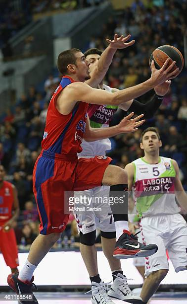 Nando De Colo #1 of CSKA Moscow competes Tornike Shengelia #7 of Laboral Kutxa Vitoria with in action during the Euroleague Basketball Top 16 Date 2...