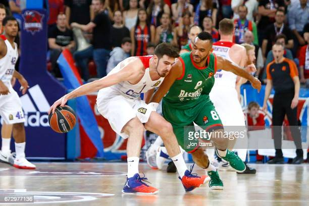 Nando de Colo #1 of CSKA Moscow competes with Adam Hanga #8 of Baskonia Vitoria Gasteiz during the 2016/2017 Turkish Airlines EuroLeague Playoffs leg...