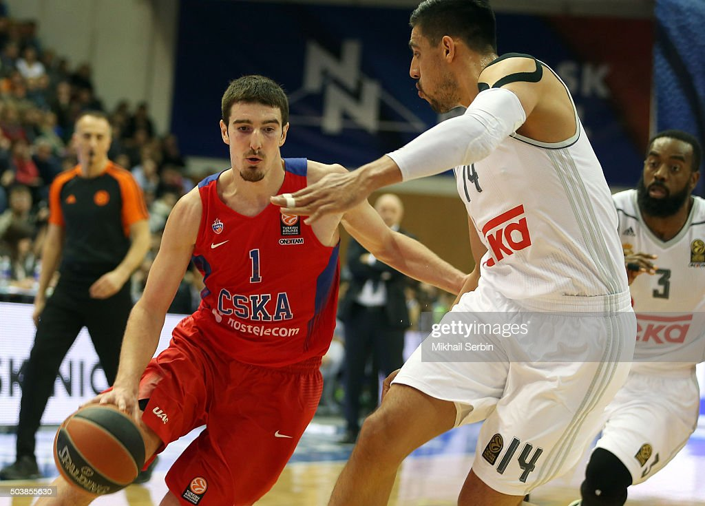 Nando De Colo #1 of CSKA Moscow competes with Gustavo Ayon #14 of Real Madrid in action during the Turkish Airlines Euroleague Basketball Top 16...