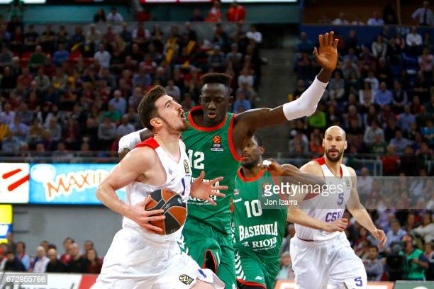 Nando de Colo #1 of CSKA Moscow competes with Ilimane Diop #12 of Baskonia Vitoria Gasteiz during the 2016/2017 Turkish Airlines EuroLeague Playoffs...